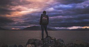 hiker looking at beautiful landscape